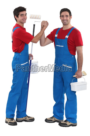 craftsman painter and his apprentice shaking
