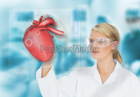 doctor consulting heart diagram on touchscreen