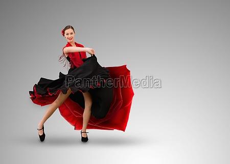 smiling flamenco dancer on grey background