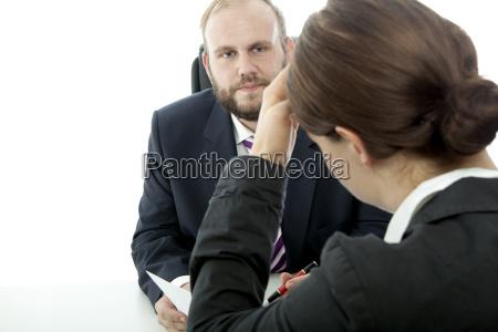 beard business man brunette woman at