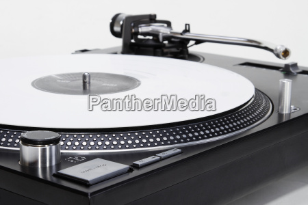 turntable with white vinyl record