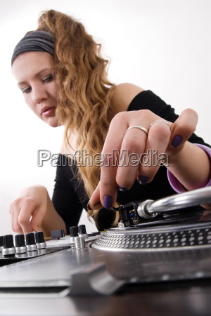 female dj puts needle on vinyl