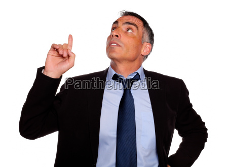 attractive executive looking and pointing up
