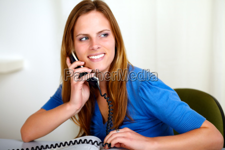 caucasian smiling blonde woman on phone