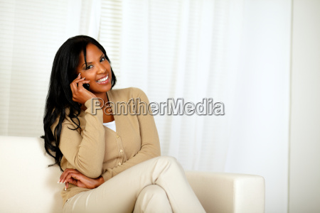 black woman smiling at you while
