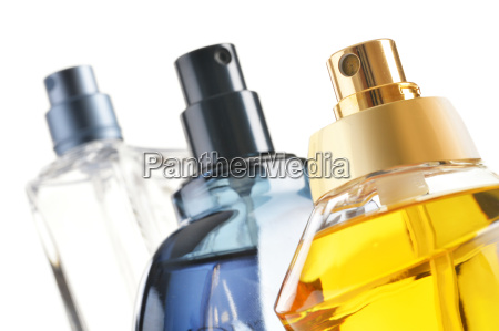 composition with perfume bottles on white