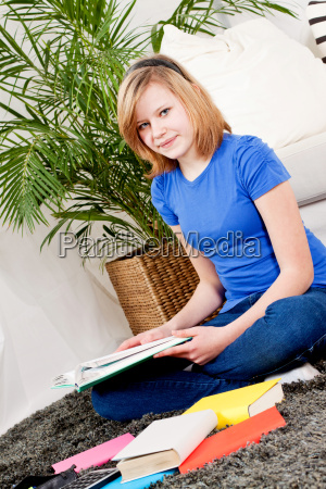 young teenager girl does homework