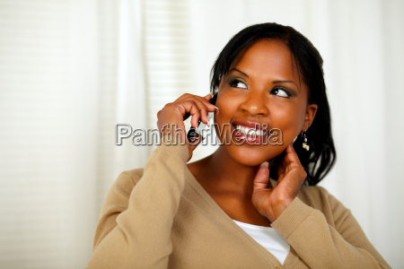 independent young woman speaking on cellphone