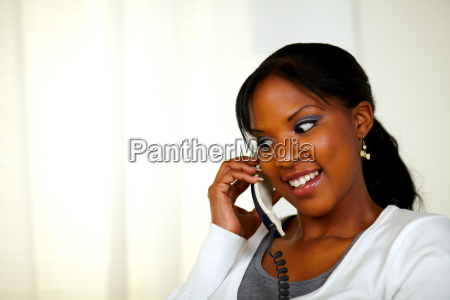 attractive female smiling and conversing on
