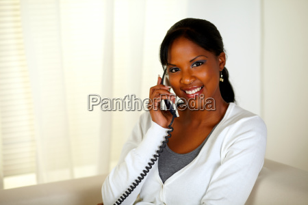 relaxed woman looking at you while