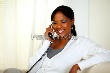 beautiful black girl conversing on phone