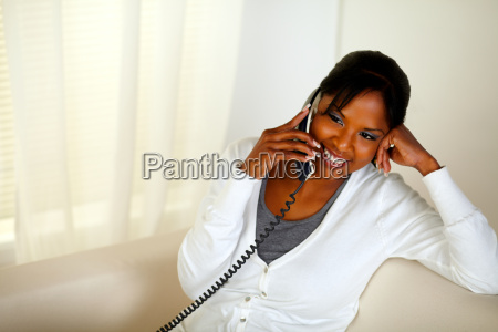 relaxed black girl smiling and conversing