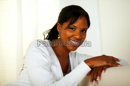 beautiful afro american woman smiling at