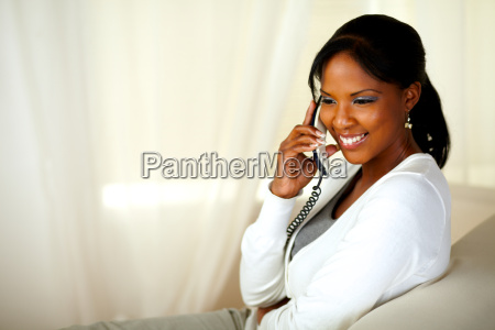 beautiful young woman smiling on phone