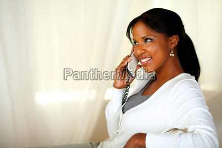 beautiful young female smiling on phone