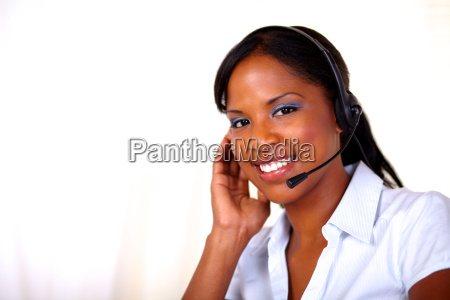 attractive receptionist smiling and looking at