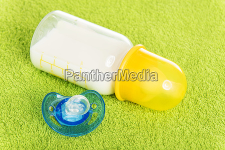 baby milk bottle and dummy
