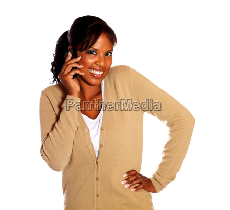 charming young woman speaking on cellphone
