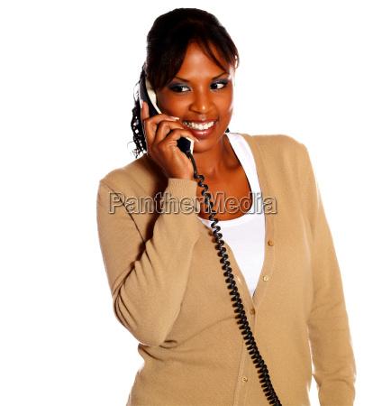 adult black woman speaking on phone