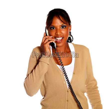 charming female talking on phone looking