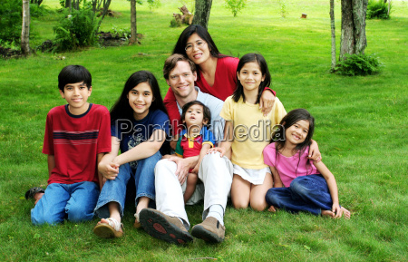 happy large multiracial family sitting on