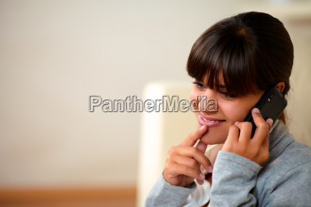 attractive young woman conversing on mobile