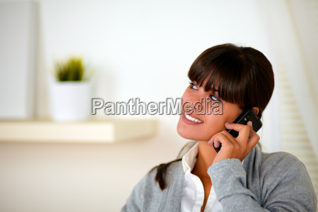 young woman talking on cellphone looking