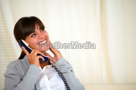 smiling pretty woman conversing on phone