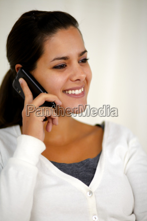 beautiful young woman speaking on cellphone