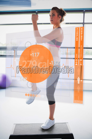 woman doing exercise with futuristic interface