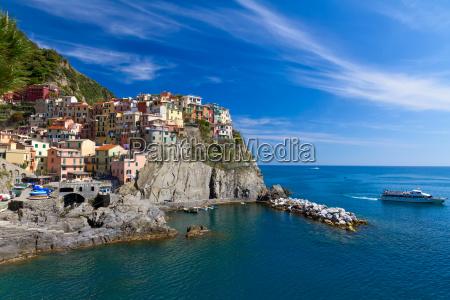 village of manarola with ferry cinque