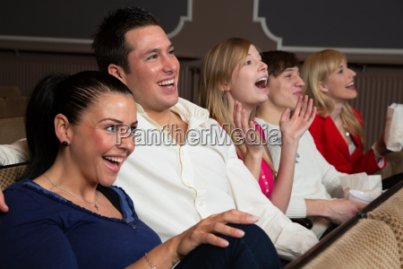 laughing spectators in a cinema