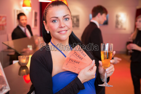 woman presenting tickets