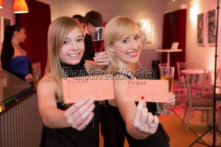women presenting tickets