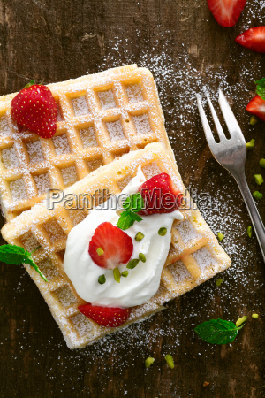 delicious waffle topped with cream