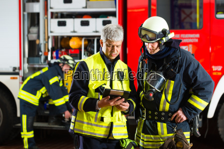 firemen use planning on tablet