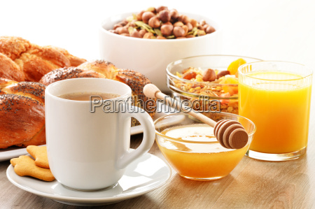 breakfast including coffee bread honey orange