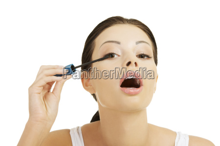 woman face with mascara brush