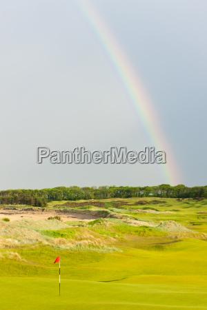 rainbow over the golf course st