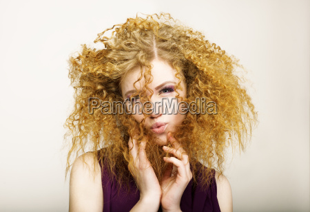 embarrassment shaggy red haired curly woman