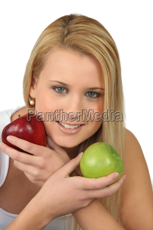 blond woman choosing between red and