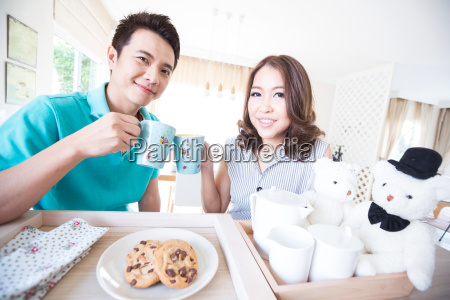 young happy couples breakfast