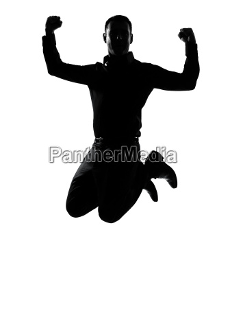 one business man jumping powerful silhouette