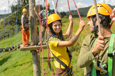 young couple in safety equipment adventure