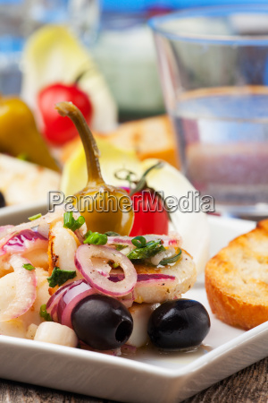 greek salad of grilled squid