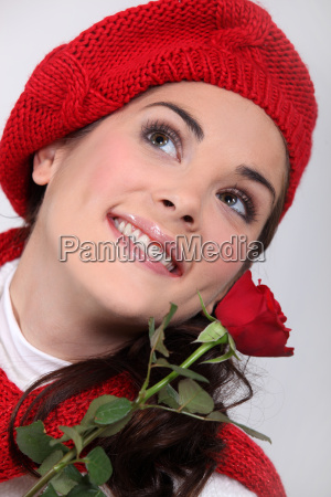 happy brunette holding a red rose
