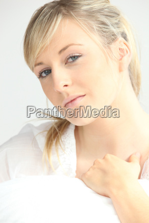 young woman under covers