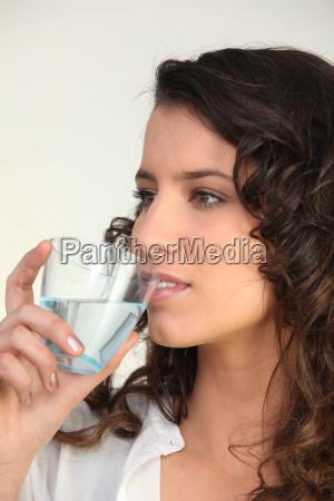 brunette drinking water