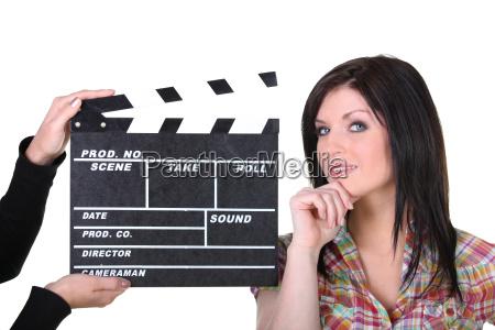a woman posing near a movie
