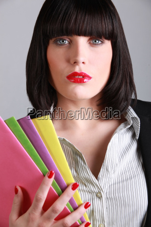 attractive businesswoman on gray background
